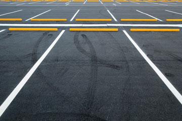 Yellow Bumper Blocks In Parking Lot
